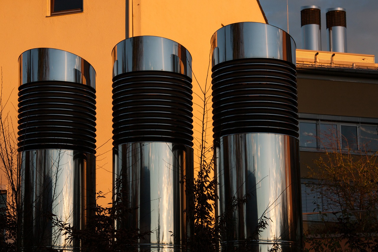 Metal vents on a rooftop at sunset