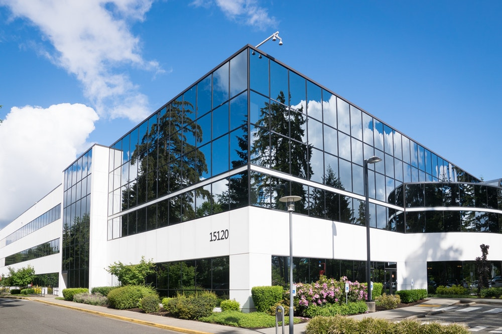 Exterior of office building with reflective glass windows