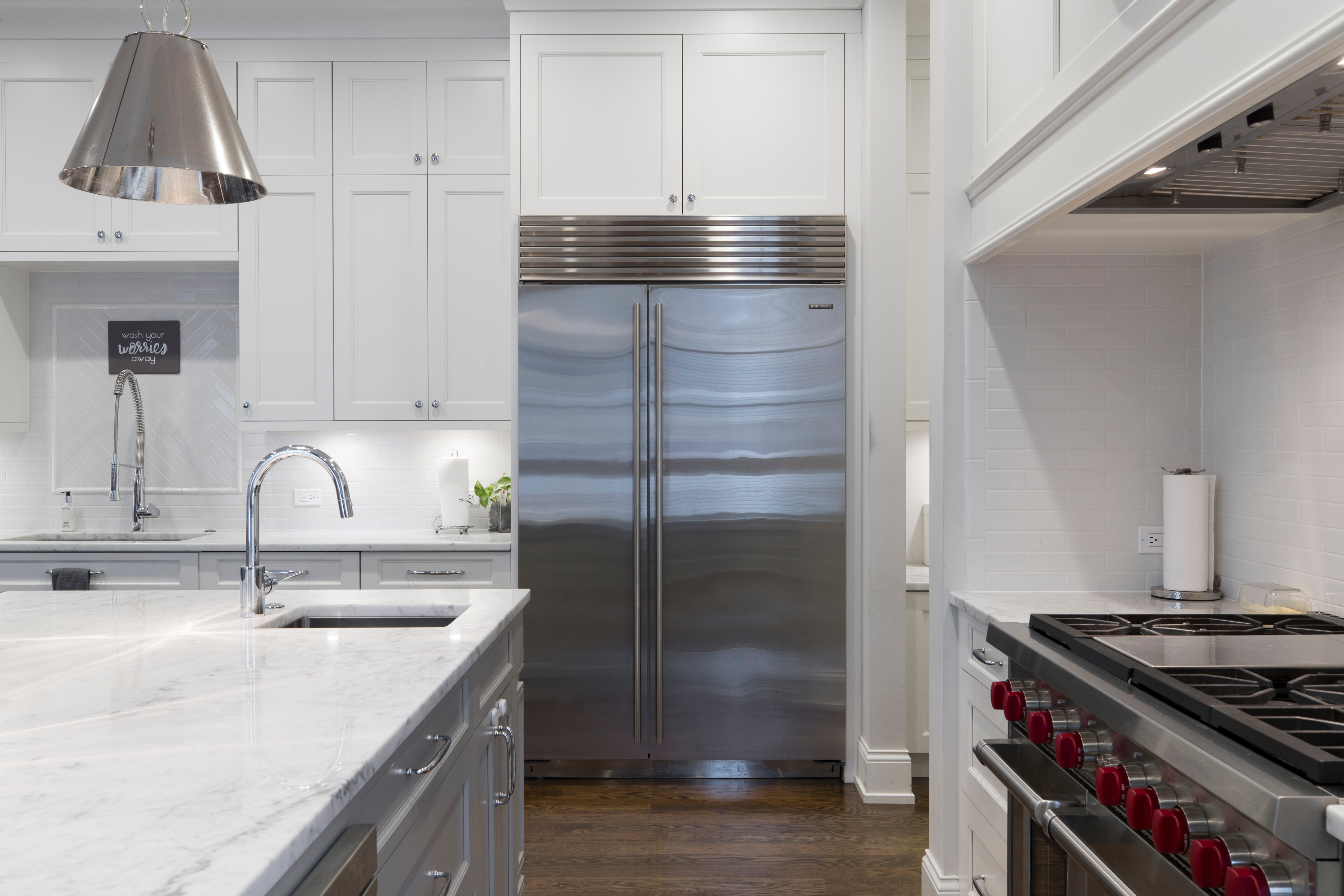 Large open kitchen with a stainless steel refrigerator