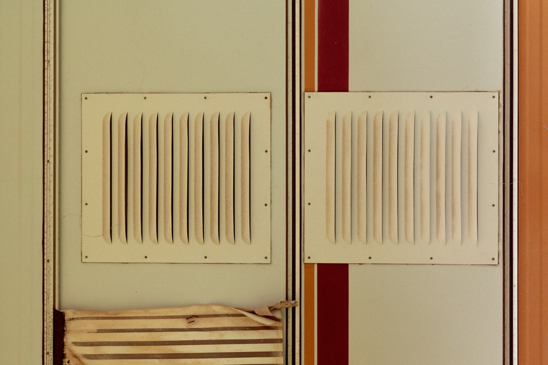 Two vents on a striped wall