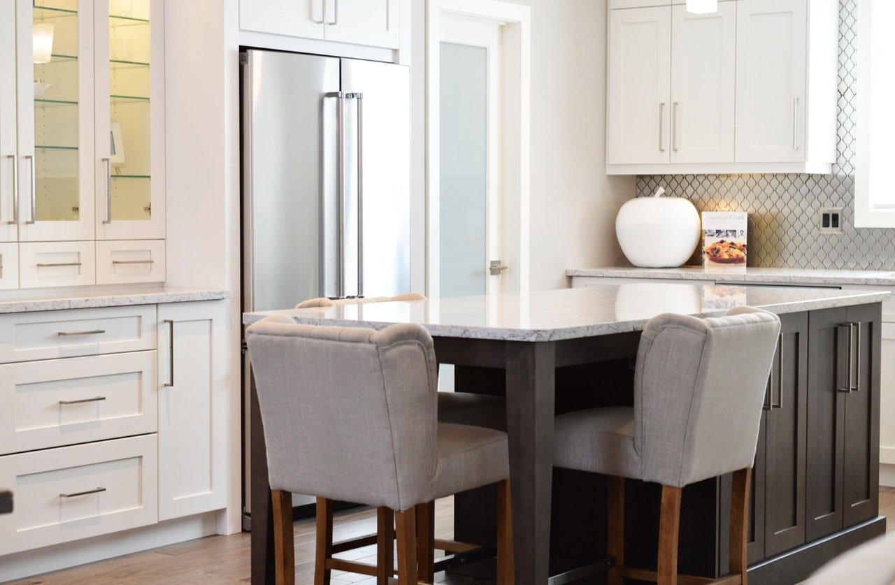Open kitchen with fridge and table