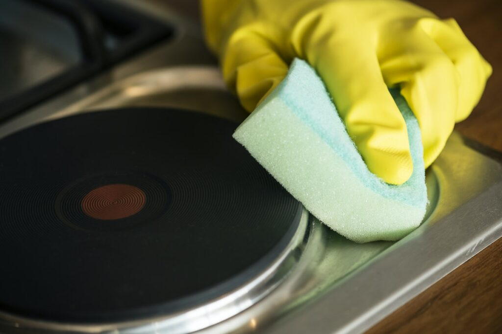 gloved hand scrubbing with sponge
