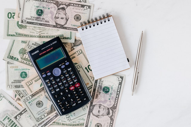 money and calculator and notepad