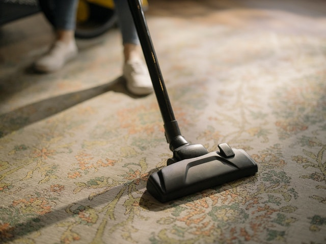 vacuuming carpet to help Kissimmee air conditioning