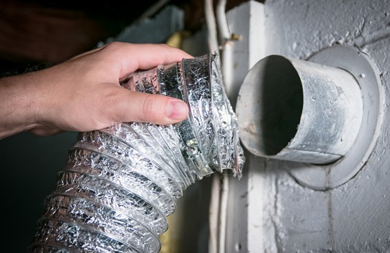 hand placing air duct